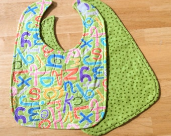 "quilted baby/toddler bib - green abc print, velcro closure, reversible, 10"" x 13 1/2"""
