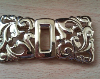 gold coloured buckle style brooch