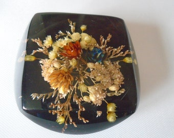 resin paperweight in black with dried flowers