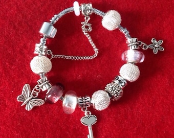 Charm Bracelet - friendship - silver plated with flower, key & butterfly charms