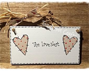 The Love Nest Plaque