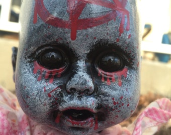 Satanic baby doll, hand painted