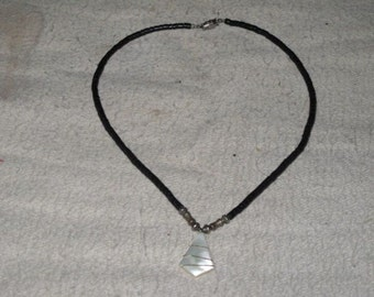 Vintage Puka Shell choker with Shell wrapped with gold wire