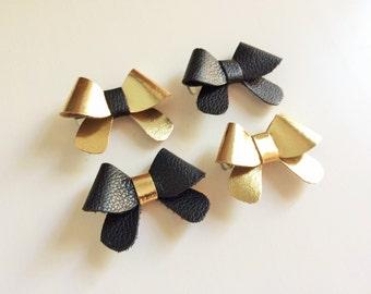 "Set of four: metallic gold w/ black center, black, metallic gold & black with gold leather ""Helen"" bows - small - headband - alligator clip"