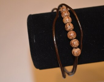 Triple strand leather and wood bead bracelet