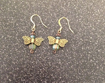 Angel Earrings With Green Glass Beads And Metal Wings