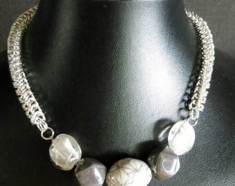 Necklace chain mail with beautiful beads in shades of gray