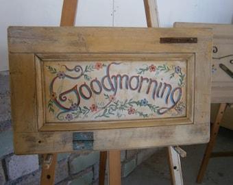 Handmade painting on old door part.
