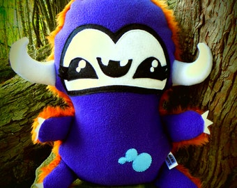Cute, kawaii, plush, soft toy, monster, vampire 'Muji Mountain Vampling' purple and ginger/orange.