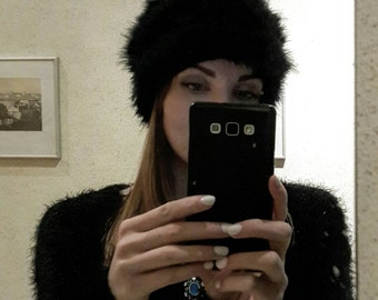 Woman's winter collection. Ostrich feathers hat.