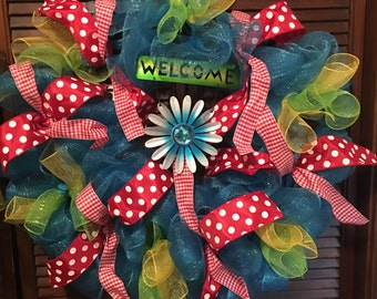 Lovely blue wreath with red ribbon