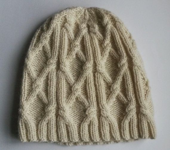 Man's Aran Beanie: handknit Aran hat in 100% wool. Original design. Made in Ireland. Traditional cream colour. Cabled knitted winter hat.