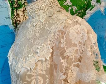 Vintage Lace Wedding Dress with a Subtle Floral Print