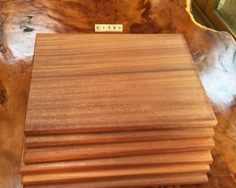 A Set of 6 solid Mahogany Place Mats that sits on its own board with stainless steel handles that makes it easier to carry