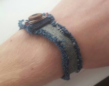 Raw denim upcycled bracelet with button closure and visible selvege