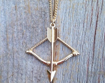 Gold Tone Bow and Arrow Necklace