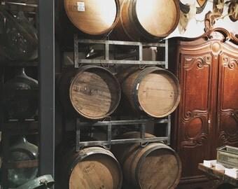 Six Wine Barrels on racks