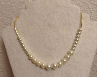 Pearl with curve tube metal beads