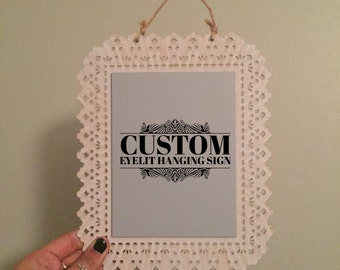 Custom Handlettering Eyelit Hanging Sign