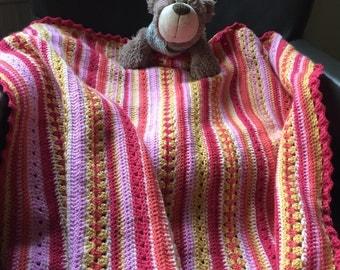 Crochet baby blanket in bright colors