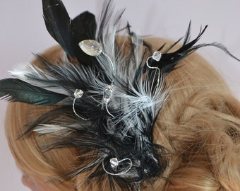 Black and ivory feather fascinator, with swarovski crystal eliments.