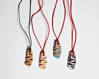 Ceramic fish necklaces