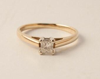 Princess cut diamond set in 14k gold size 7.5