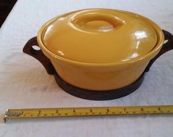 Yellow Ceramic Casserole in wooden holder