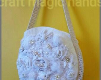 The beautiful ivory shoulder bag