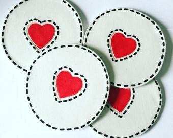 A set of 4 handmade clay, love heart coasters