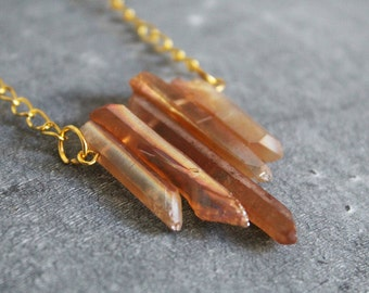 Long necklace with quartz stone pendant