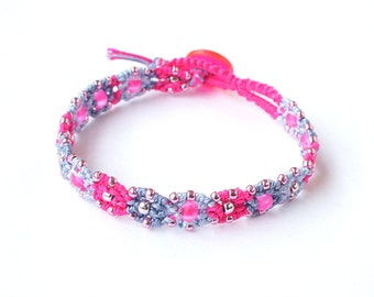 Peer's micro macrame bracelet with: steel, fluo hot pink, blue morning c lon bead cord, neon pink and silver beads and a button-loop clasp
