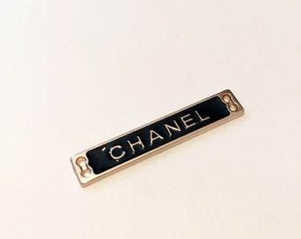Chanel metal tag label.
