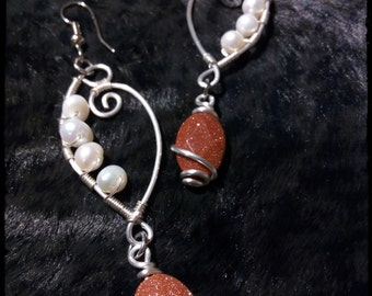 Silver plated earrings with freshwater pearls and Goldstone