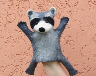 Toy on a hand raccoon , developing toy for children, puppet theater, toy bibabo, raccoon