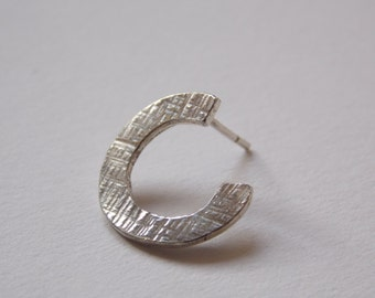 ear stud made of hammered silver