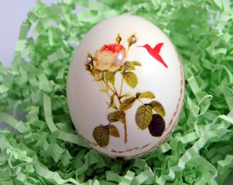 Delicate Rose, Hummingbird and Girl with jewels decoupaged onto a hollowed out real chicken egg.