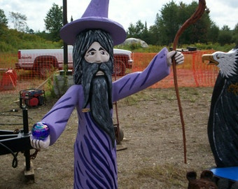 chainsaw carving wooden wizard