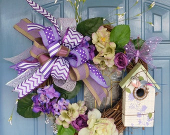 Purple Flowers and Ribbons with Birdhouse on Grapevine Wreath