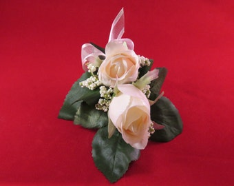 Silk Rose corsage, with pink roses and berry spray, and matching buttonholes