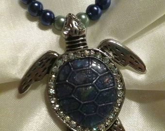 Ocean Life - Blue/Green glass pearls with Silver and Blue Seaturtle