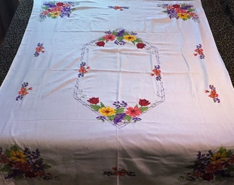 Hand stitched tablecloth with bold cross-stitched flower pattern