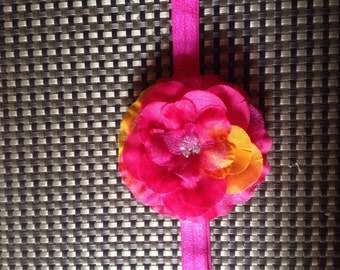 Age: 3 and Up Hawaian Flower on Pink Elastic