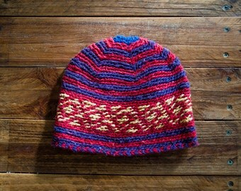 Hand woven Moroccan wool hat in blue, red and yellow