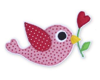 Application bird with heart flower