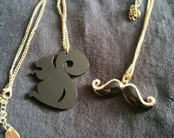 Squirrel and mustache necklaces