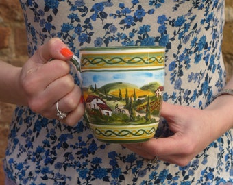 Mug hand-painted with the typical Italian decoration of Tuscan Landscape. Design and realization of our laboratory.