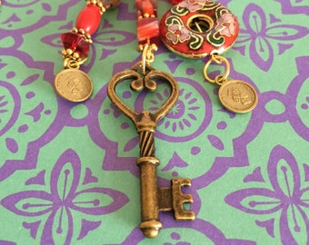 Red cloisinet and miliflora long pendant with heart key charm. By BoHoBounty
