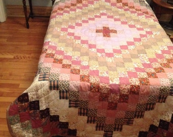 Hand quilted patchwork quilt