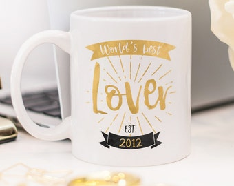 "Mug for girlfriend, or gift for wife with quote ""World's best Lover"" and a custom date"